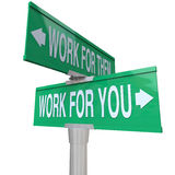 Work for You vs Them Entrepreneur Sign Start Your Own Business. Work for You words on a green road sign vs working for them telling you to start your own new Stock Photos