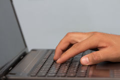 Work with your fingers on the keyboard on a laptop Stock Images
