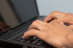 Work with your fingers on the keyboard on a laptop Stock Photo
