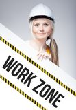 Work zone sign placed on information board, worker woman Royalty Free Stock Photo