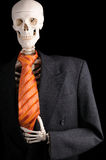 A workaholic. A skeleton with suit and tie Stock Photography