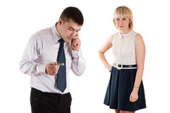 Workaholic businessman and angry wife Stock Images