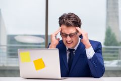The workaholic businessman overworked with too much work in office Stock Image