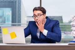 The workaholic businessman overworked with too much work in office Royalty Free Stock Photos