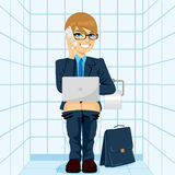 Workaholic Businessman Using Toilet Stock Photography