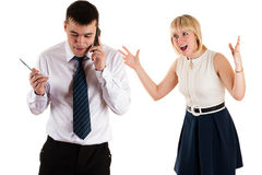 Workaholic businessman and wife Stock Image