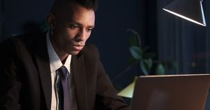 Workaholic businessman working late in office. Workaholic businessman working late on office laptop stock footage