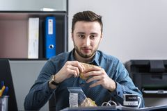 Free Workaholic Eating Breakfast While Working Royalty Free Stock Photo - 107990385