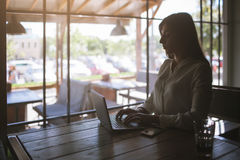 Workaholic woman working in cafe Royalty Free Stock Photography