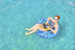 Beautiful young woman in the sea. royalty free stock photos