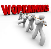 Workaholics 3d Word Pulled by Team People Working Together. Workaholics word in red 3d letters pulled up by a team of hard working people cooperating to achieve Royalty Free Stock Photos