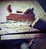 Workbench in a carpentry with planer and sawdust. And vintage effect Royalty Free Stock Photos