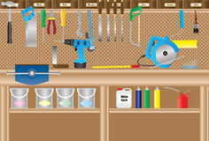 Workbench. A Workbench with Cordless Drill,Circular Saw,Handtools,Paint Cans,Paint Brush,Paint Roller,Aerosols,Oil Can,Drill Bits Stock Photos