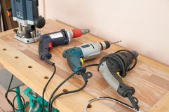 Workbench and electric drill. Stock Image