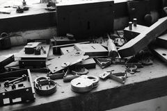 Workbench at locksmiths. Photograph of various lock parts on a workbench Royalty Free Stock Photography