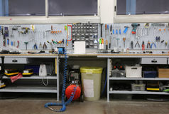 Workbench with many tools inside a mechanic workshop specialized. In repairing bicycles Royalty Free Stock Images