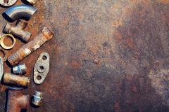 Workbench metal table with old water supply parts Stock Photography