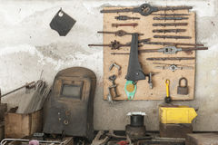Workbench. Old workbench with old work tools hanging on wall garage Stock Photography