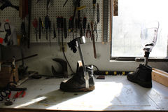 Workbench with tools, foot and shoe prosthetics. Light coming through a window Stock Photo