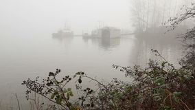 Workboats at Dock, Fraser River Fog. Workboats at dock on a foggy morning on the Fraser River near Vancouver. British Columbia, Canada stock video footage
