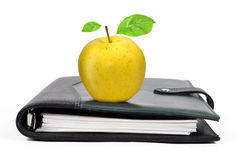 Workbook with an Apple Stock Photography