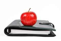 Workbook with an Apple Stock Photo