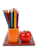 Workbook and  color pencils. With apple isolated on white background Royalty Free Stock Images