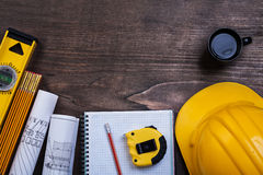 Workbook pencil cup of coffee and construction Royalty Free Stock Image