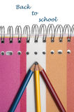 Workbook with three pencils Stock Photo