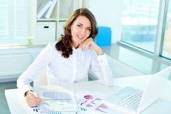 Workday. Pretty woman working at office on a workday Royalty Free Stock Images