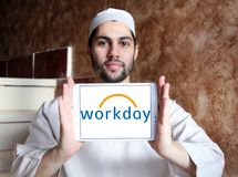 Workday company logo. Logo of Workday company on samsung tablet holded by arab muslim man. Workday, Inc. is an on‑demand cloud-based financial management and Stock Photos