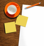 Workdesk. Work desk with plain paper and pencil, sticky notes and coffeecup Royalty Free Stock Image