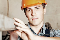 Worker. Industrial theme: a worker at a manufacturing area Stock Photo