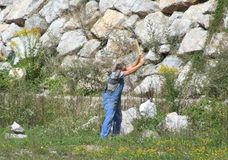 Worker. Man with sledgehammer braking rocks Royalty Free Stock Photos