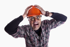 Worker. A desperated contractor with a funny expression stock photos