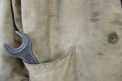 Worker. 's jacket and big wrench royalty free stock image