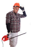 Worker. A construction worker (mature man on 40s) with a frustrated expression Royalty Free Stock Images