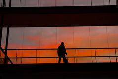 Worker. Business man in the modern buildind at sunset Royalty Free Stock Photo