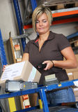 Worker. Scans pallets and boxes in the warehouse Stock Image