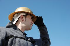 Worker. Male worker holding his safety blue sky Stock Photography
