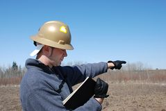 Worker. Male worker with safety helmet pointing at far distance Stock Photos