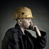 Worker. Young worker against a dark backgroun Royalty Free Stock Images