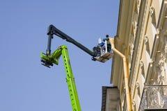 Worker. Renovating the facade in Saint-Petersburg Stock Photos