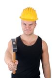 Worker. A young worker in helmet with hammer Stock Photography