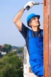 The worker. In a dark blue special clothes Stock Photography