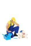 Worker. Repair the broken house Stock Photography