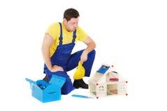 Worker. Repair the broken house Royalty Free Stock Photo