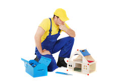 Worker. Repair the broken house Royalty Free Stock Images