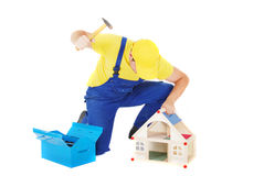 Worker. Man repair broken house Royalty Free Stock Image