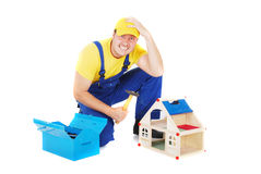 Worker. Man repair broken house Stock Photography
